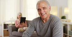 Handsome senior man smiling at camera Stock Photos