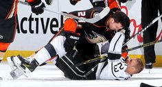 Simon Despres #24 of the Anaheim Ducks mixes it up with Dustin Brown #23 of the Los Angeles Kings