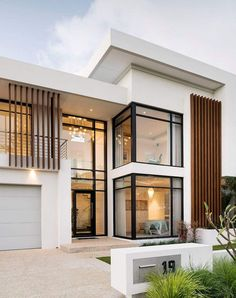 This stunning contemporary two-storey home has been shaped to fit the contours of a sloping block, harness ocean views, create a north-facing backyard sanctuary for year-round enjoyment and deliver well-zoned accommodation for a family of five. Modern Exterior House Designs, Modern House Facades, Modern Architecture House, Modern House Design, Modern House Plans, Exterior Design, Architecture Design, Modern Home Exteriors, Luxury Homes Exterior