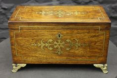 "Antique Regency Rosewood Tea Caddy.  Check out the brass griffin feet!  7""H x 12""W"