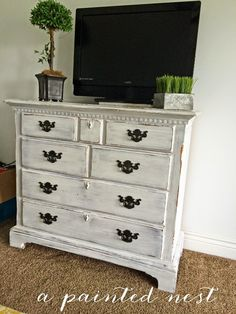 White Antiqued and Distressed 4 Drawer Dresser, this is  Perfect for a bedroom entertainment center!