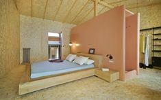 Housed in its own discrete shell, Casa Mac's master bedroom is divided down the middle by a pink-walled frame that houses a toilet cubicle on one side and a shower on the other. Built In Desk, Built In Storage, Single Bedroom, Master Bedroom, Mac, Micro Apartment, Concrete Stairs, Brick And Wood, Timber Structure