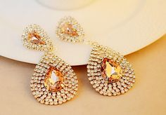 Elegant rhinestone earrings with crystal cabochons. Fall in love with them at first sight. How about you? ^_^
