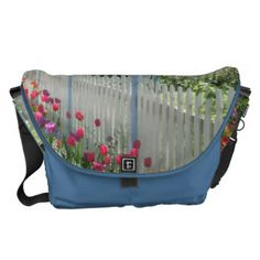 #Spring #tulips #garden along #whitepicketfence #flowers #flower #tulip #photography #photo on #messengerbag #bag @Zazzle Inc. at http://www.zazzle.com/fabricatedframes/bags #blue #oceanblue #aquablue #pink #green