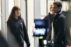 Image result for jamie dornan with chair