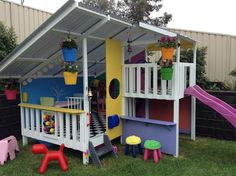 Cute cubby house with lights and garden.