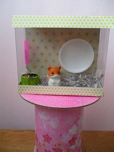 I love cute crafts that make fun things for our American Girl Dolls. So cute! We need a Hamster cage!