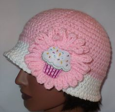 Crochet Pink Cupcake hat with white trim.