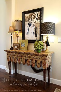 entry table.....love the multiple lamps on the table.