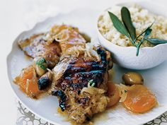 Moroccan Chicken with Apricot-and-Olive Relish | This grilled chicken dish transforms the sweet-savory elements of a Moroccan tagine—apricots, olives, couscous—into a light, summery meal. The mar...