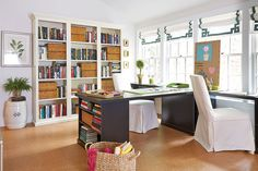 The craft room in Bunny Wiliams' Southern Living Idea House is one of our favorite space. She arranged three desks in a T shape to create 3 workspaces and Parsons chairs on casters that zoom around the cork floor with no trouble!