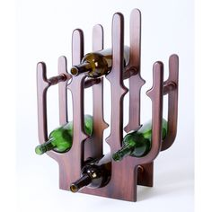 "Wooden wine racks for nature lovers in India, The Cactus (Rack) - Shop.InOnIt for Rs.2800  Nature inspires so many designs that we see all around us. This wooden wine rack exudes subtlety. Inspired from the design of the cactus plant, the abstract construction helps hold 7 bottles of 3.5"" diameter or less. Finish: Walnut. Dimensions: L 15.5 x B 6 x H 21.25 inches"