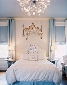 Sky Blue ceiling, blue window covering, blue bedskirt and blue toile medallion headboard make this a simple but pretty girls room.