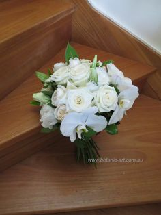 roses and orchids with a touch of green is a beautiful classic bouquet