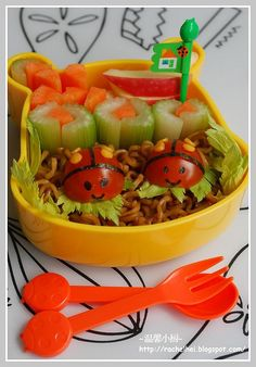 Ladybug bento box.  So, cute!  what a clever way to put the celery and carrot sticks
