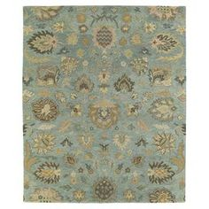 "Add a pop of pattern to your living room or den with this hand-tufted wool rug, showcasing a botanical-inspired motif for stylish appeal.  Product: RugConstruction Material: 100% WoolColor: Light blue, light brown, chocolate brown, beige, sand, gold, sage, olive and taupeFeatures:  Hand-tuftedMade in IndiaPile Height: 0.33"" Note: Please be aware that actual colors may vary from those shown on your screen. Accent rugs may also not show the entire pattern that the corresponding area rugs ..."