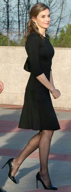 Queen Letizia - Black flared BOSS 'Heidin' dress - BOSS Hugo Boss'Staple R' black crocodile-embossed pumps -  black quilted Prada shoulder bag.