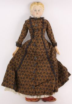 A beautiful Greiner paper mache head doll with paper label on back. Wearing gorgeous Civil War dress, red leather boots. NFS yet... maybe in future when I can part with her. check back into my ebay doll shop. :)