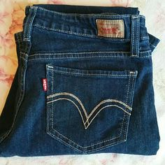 NWOT Levi's superlow 518 Jeans 7 Levi's superlow 518 dark wash jeans size 7M. Inseam measures 32 inches. Waste is 15 inches laying flat. Tiny distress at bottoms as pictured. Came like that. These are NWOT Levi's Pants Boot Cut & Flare