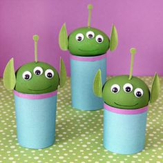 Toy story alien eggs     Hard-boiled eggs dyed alien green (using Easter egg dye or gel food coloring) or plastic eggs of a similar size and color   Scissors   Craft paper (green, blue, and purple)   Toilet tissue tubes or paper towel tube   Paper hole punch   Glue stick   Glue dots   Fine-tipped black marker