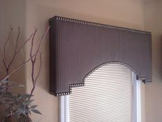 wood cornice boxes for windows | Shaped cornice box with head-to-head tacks. Made by Nouveau Designs.
