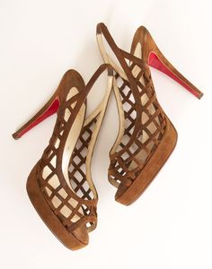 Christian Louboutin brown suede open-toe platforms.