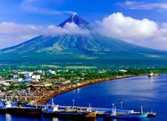 """Mayon Volcano, also known as Mount Mayon, is an active volcano in the province of Albay, on the island of Luzon in the Philippines. Renowned as the """"perfect cone"""" because of its almost symmetric conical shape Philippines Tourism, Voyage Philippines, Les Philippines, Philippines Culture, Cebu, Manila, Volcan Eruption, Mindanao, Davao"""