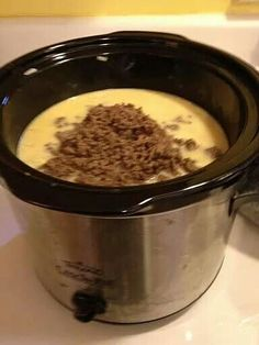 Crock Pot Cheeseburger Soup  Ingredients: 1 lb ground beef (browned) 2 lb Velveeta 2 lb shredded hashbrowns 6-10 bacon strips (cooked & crumbled) 30 oz chicken broth