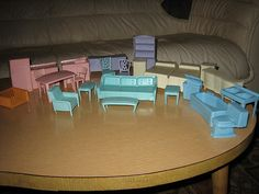 I sooo remember this plastic dollhouse furniture. I played with this for hours. Hmmmm.............. so that's when it all started!