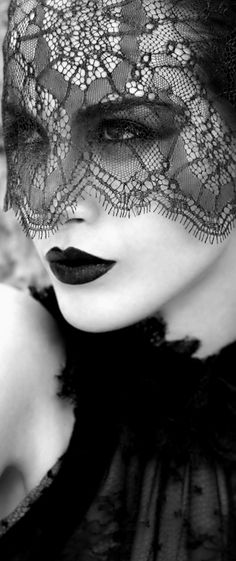 B&W, Black lace veil, young woman's face in semi profile.
