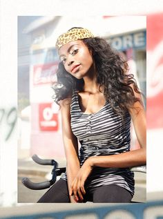 Gina from Namibia. Women fashion Woman sitting on bike. www.patriklinden.se