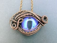 Violet Dragon Eye Pendant with Copper Wirework by adornjewels on Etsy Pin to save or click to buy this one of a kind pendant