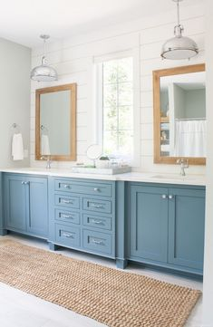 Sherwin Williams Blustery Sky for upstairs bathroom vanities. Lake house master bathroom featuring Blustery Sky blue cabinets, white shiplap, and warm wood tones. A pedestal tub and chrome accents complete the look. Lake House Bathroom, Bathroom Windows, Bathroom Cabinets, Bath Window, Bathroom With Window, Bathroom Shop, Bathroom Mirrors, Wall Mirrors, Home Bedroom