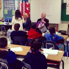 Amy & Brian Handing Out Shoes To Mrs. Spencer's 2nd Grade Class