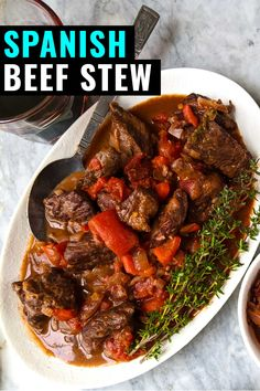 Easy Crockpot Spanish Beef Stew Recipe Classic Spanish Beef Stew with Roasted Red Peppers - Bacon is Magic Beef Stew Crockpot Easy, Slow Cooker Beef, Slow Cooker Recipes, Crockpot Recipes, Cooking Recipes, Spanish Beef Stew Recipe, Spanish Stew, Recipes With Beef Stew, Spanish Meals