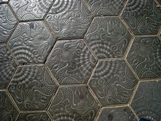 These are the tiles of the streets of Barcelona.  Antonio Gaudi architect designed them. Sidewalk by rainy city.
