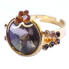 Golden ring with brown crystal  http://enewmall.com/women-rings/