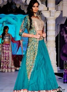Swap you regular party look with this ultra modern piece of traditional wear. It is inspired from twenty first century designer fads that exert novelty and peppiness transforming you into a diva that has never been seen before. Grab this ravishing blue attire to experience the difference in your couture.