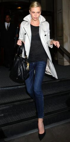 Look of the Day › August 20, 2011 WHAT SHE WORE Theron bundled up in a chic Burberry trench and jeans while out in London.