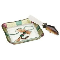 Royal Wulff -Fly Fishing Appetizer Plate with Spreader, Big Sky Carvers by Demdaco. $17.00. Clear Streams Glass. Coordinating spreader. This glass fly fishing appetizer plate features a picture of a lure and has a matching spreader with a rainbow trout handle. Clear Streams Glass by Lori Siebert. Size: 4.75 square Not intended for microwave use. Hand wash only to preserve colors.