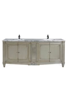 The Addicott vanity unit is shown in Dusty White with details in Gold Leaf and a Carrara marble top.