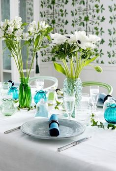 Great summer table setting using blue, green and clear glass wear