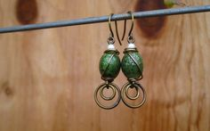 Antique+Brass+Wire-wrapped+Ceramic+Green+Oval+Bead+by+SparrowWares