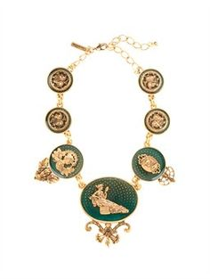 """TOILE NECKLACE, $890.00 DETAILS With nods to the runway, this ornate statement necklace is comprised of linked rococo motifs inspired by toile de Jouy prints used in our ready-to-wear collection. The modern heirloom is crafted with our exclusive Russian gold hand-painted with enamel for a Byzantine-like finish.  • 16"""" with a 4"""" extender  • Front area is 3"""" from top to bottom  • Pewter / brass / resin  • Lobster and extender closure  • Made in USA Style #3J010"""