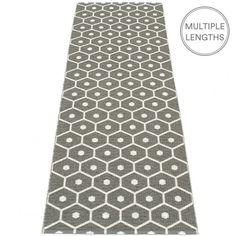 The Pappelina Honey runner features a striking motif inspired by the hexagonal cells found in a beehive.   Woven from soft charcoal plastic, and using traditional Swedish techniques, a Pappelina runner can be used in all areas of the home.  They are reversible, dust and dirt repellent, and fully washable, although a quick vacuum is probably all they will ever need to keep them looking good as new.