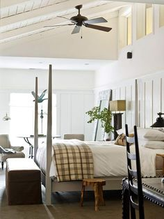 This winter white room is light and sunny, and invite you to get cozy. I love the plaid throw at the end of the bed.