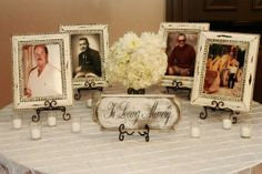 Wedding Idea: A photo table in memory of those so dear to bride and groom's heart who could not attend their special day.