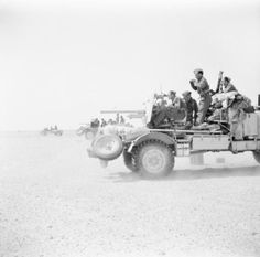 Lorry-mounted 2-pdr anti-tank guns on a practice shoot in the Western Desert, 3 May 1942.