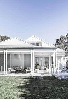 A crisp coat of white paint instantly freshened up the facade and exterior of this modern beach house.