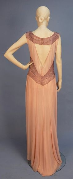 BEADED CHIFFON EVENING GOWN with CAPE, 1930's. Sleeveless sweep trained pink gown having bands of plum iridill beads at waist, shoulder, and band above the triangular open back, (no under dress). Plum chiffon floor length cape. Back